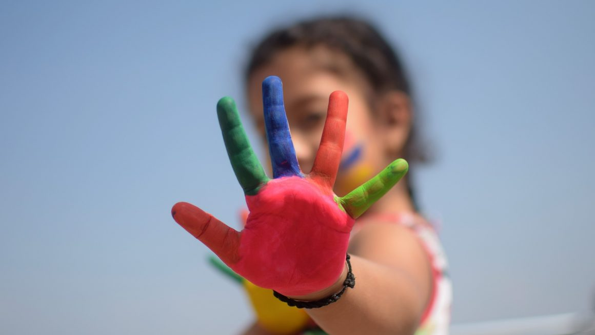 Girl with coloured fingers